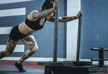 tattooed woman training